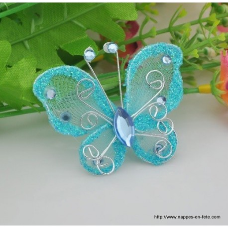 Papillon turquoise pour d co de table de f te for Objet deco couleur turquoise