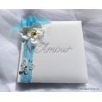 Livre d'or turquoise et blanc avec orchidée et papillon