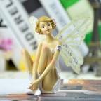 figurine jeune fille fée assise pour anniversaire ou communion