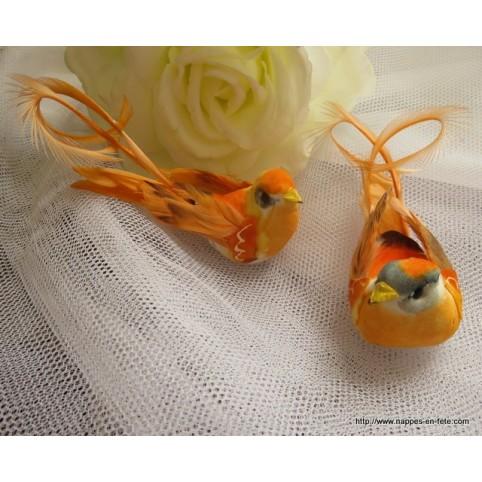 couple d'oiseaux artificiels orange à longue queue