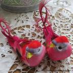 oiseaux rouge artificiels à longue queue
