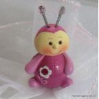 Figurine bébé coccinelle rose fushia pour baptême